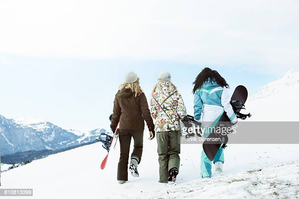 3 young women on winter holiday - female skier stock pictures, royalty-free photos & images