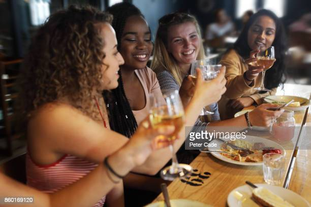 Young women out for dinner in restaurant