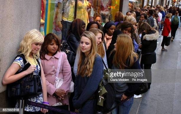 Young women outside Topshop on Oxford Street in central London waiting for the doors to open on the first full shopping day of the store selling the...