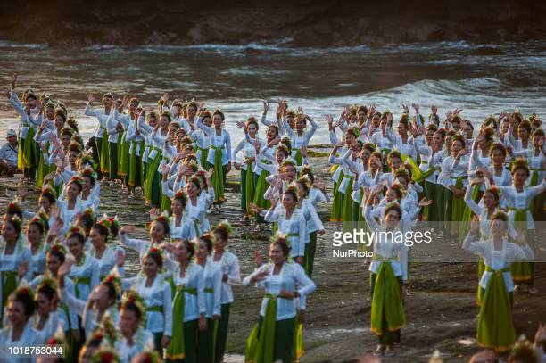 1800 young women perform the colossal dance Rejang Sandat Ratu Segara at Tanah Lot 2018 Festival on August 18 2018 in Tabanan Bali Indonesia