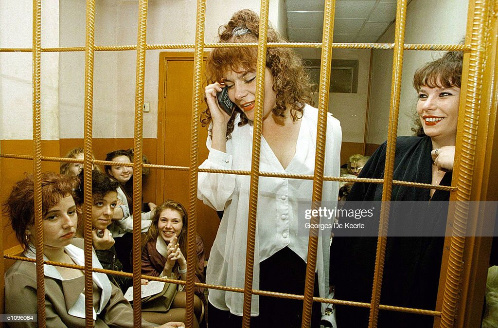 Young Women Picked Up By Police For Prostitution Make A Call To Their Friends On A Cell Phone To Arrange Their Release For A Holding Cell May 23, 1997 In Moscow, Russia. Prostitution Has Become A Major Problem In Russia As Low Wages Have Driven Women To Search For A Way To Make Money.