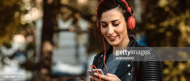 young women - headphones stock pictures, royalty-free photos & images