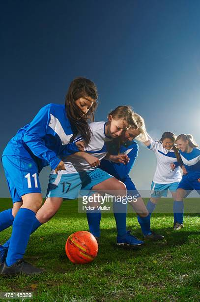 Young women playing football