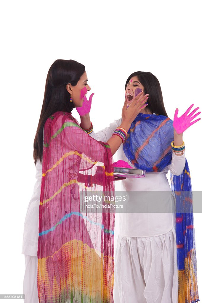 Young women playing holi : Stock Photo