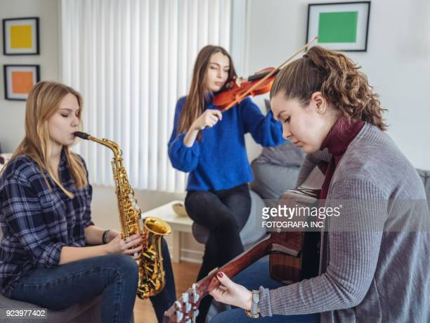 young women playing music - violin family stock photos and pictures