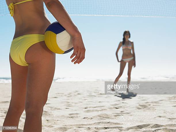Young women playing volleyball