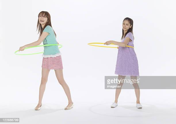 Young women playing with hula hoops