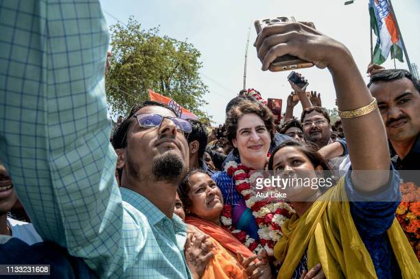 Young women pose for a selfie with Congress Party's Priyanka Gandhi during her campaign on March 27, 2019 in Uttar Pradesh, India. Congress leader...