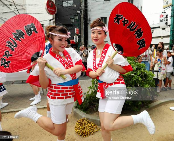 Young women pose for photographs after the popular 'Gal Mikoshi' is paraded at Tenjinbashisuji shopping street on July 23 2017 in Osaka Japan The...