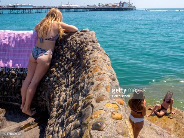 Young women pose for photos near to Brighton Palace Pier After some of the worst weather the United Kingdom had seen for centuries after severe...