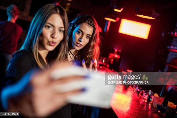 Young women posing and taking selfie image