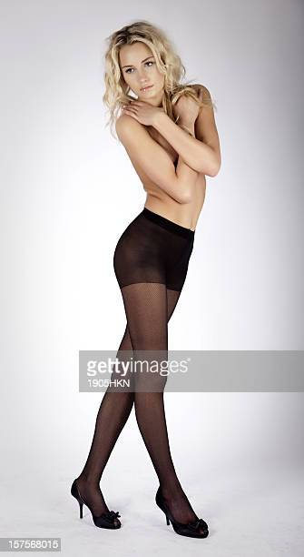 young women posing - women wearing pantyhose stock photos and pictures