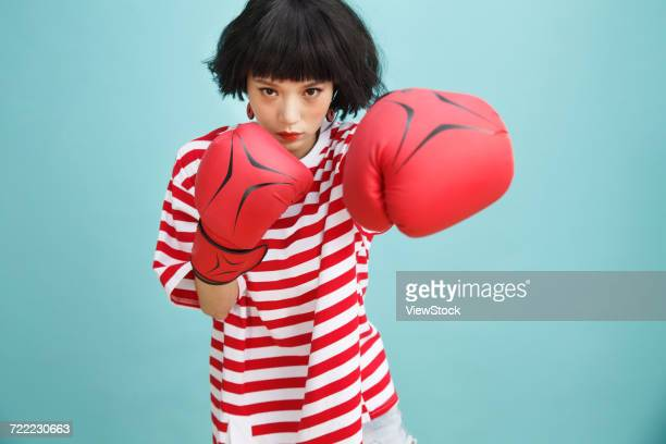 Young women practice boxing