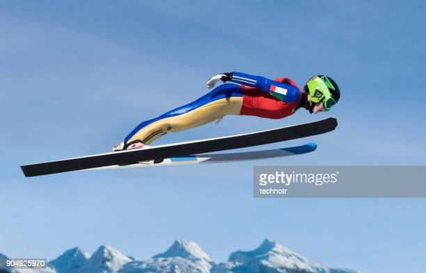 young women practicing ski jumping - ski jumping stock pictures, royalty-free photos & images