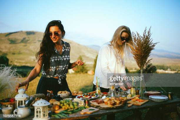 young women preparing food for picnic in the countryside - tapas stock photos and pictures