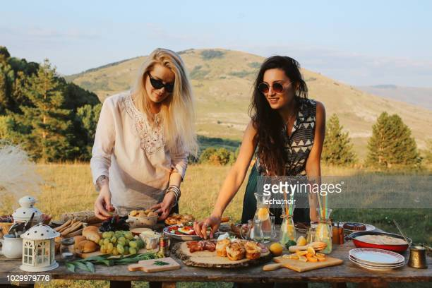 young women preparing food for picnic in the countryside - bosnia and hercegovina stock pictures, royalty-free photos & images