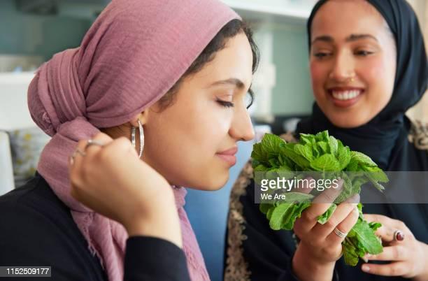 young women preparing ramadan iftar meal - beautiful ramadan stock pictures, royalty-free photos & images