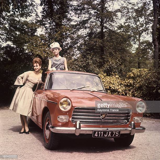 Young Women Presenting The New Peugeot 404 In France On 1960