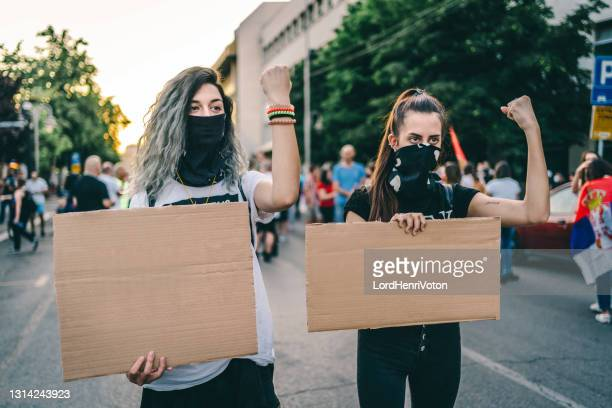 young women protesters holding blank placards - placard stock pictures, royalty-free photos & images