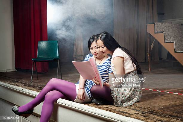 young women reading and rehearsing script - actress stock pictures, royalty-free photos & images
