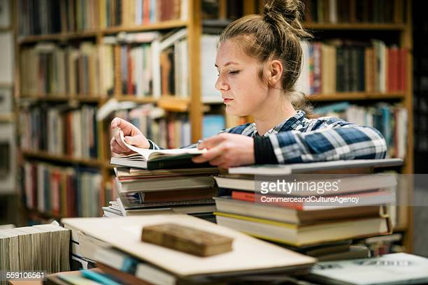 Young women reading in second hand bookstore
