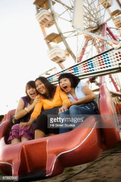 Young women riding a roller coaster
