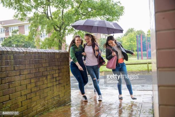 Young Women Run In The Rain