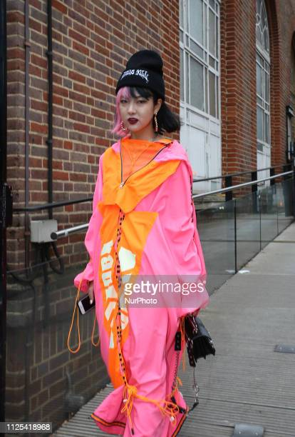 Young women seen on a street in front of London Fashion Week show space on February 16, 2019 in London, England. Members of public who attend the...