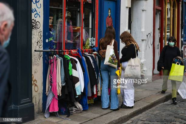 Young women seen outside a vintage clothing store in Dublin city center. Ireland takes another step towards normality with all non-essential retail...