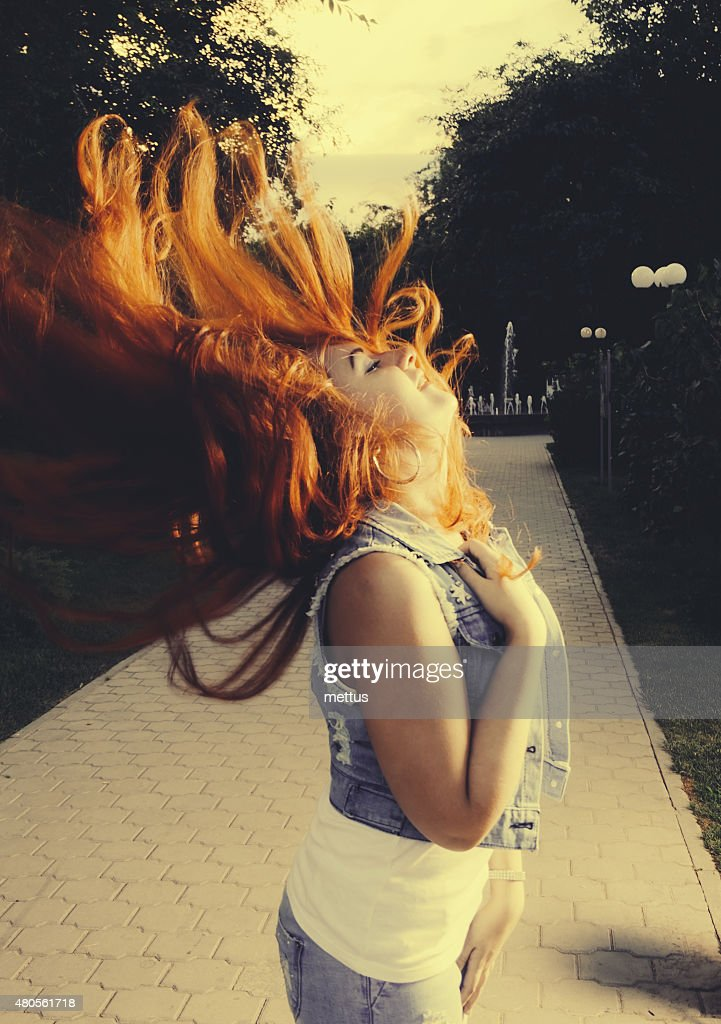 Young  women shake her hand with long beautiful red hair : Stock Photo
