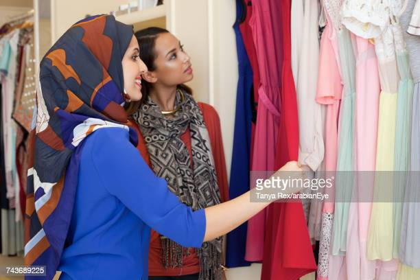 Young women shopping at boutique.