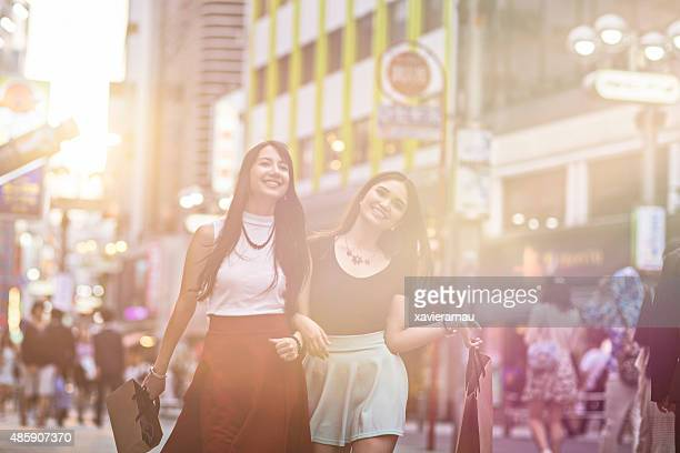 Young women shopping at sunset in Tokyo