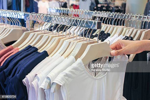 young women shopping clothes in the mall - railings stock photos and pictures