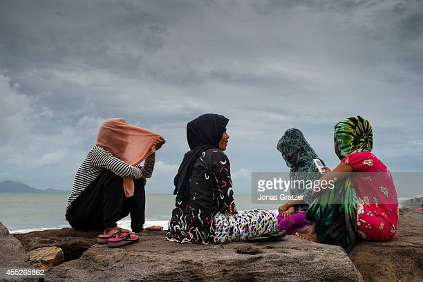 Young women sitting at the Banda Aceh north coast where some of the largest tsunami waves in December 2004 struck the province The tsunami of...