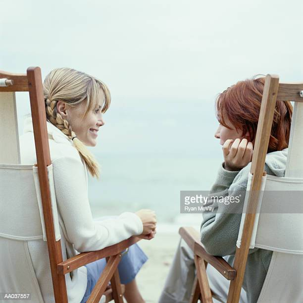 Young Women Sitting in Beach Chairs, Talking