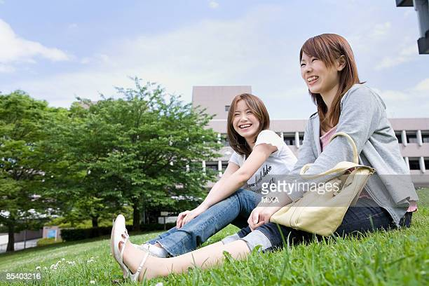 Young women sitting on lawn