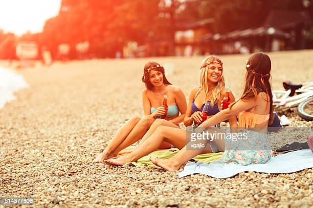 Young women sitting on the beach.