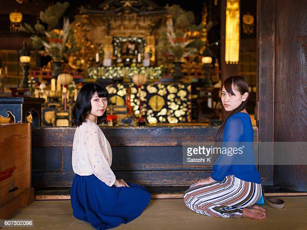 Young women sitting straight in temple