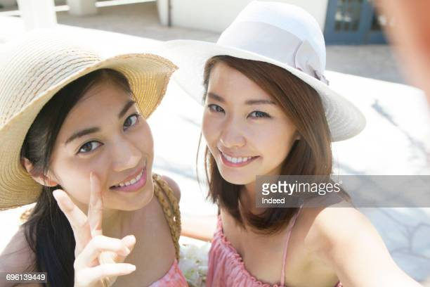 Young women smiling at camera