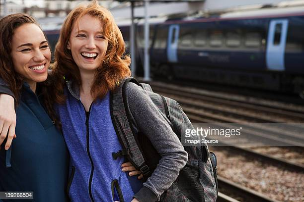 Young women smiling at train station