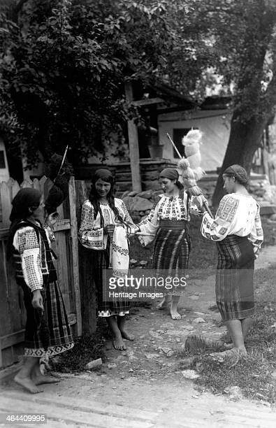 Young women spinning wool Bistrita Valley Moldavia northeast Romania c1920c1945 Depicting customs and traditional labour in the rural Carpathian...