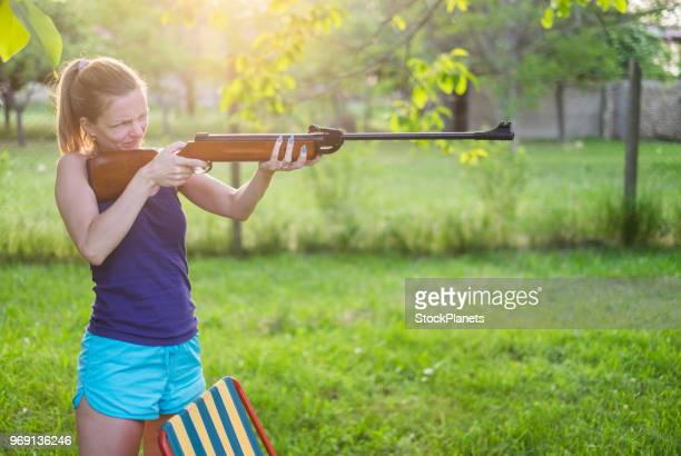 young women standing aiming at the target - shotgun stock pictures, royalty-free photos & images