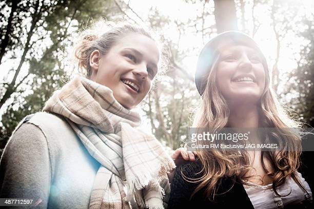 Young women standing in forest