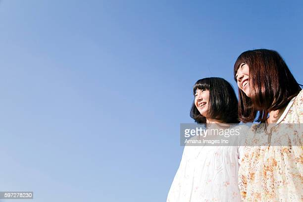 Young women standing side by side, Japan