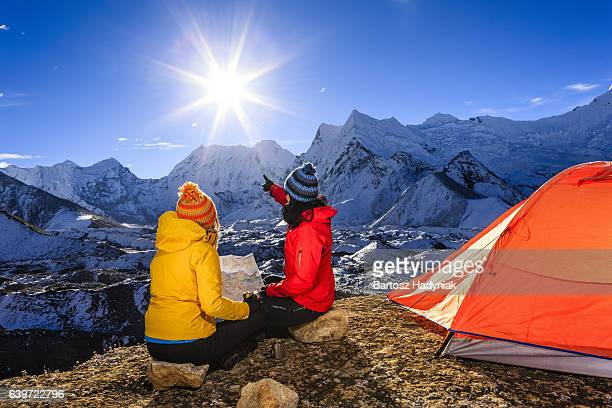 Young women studying map in Himalayas, Mount Everest National Park