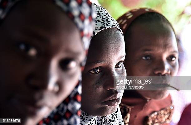 Young women suffering from obstetric fistula wait at the health centre of the DIMOL nongovernmental organisation in Niamey on February 19 2016 Niger...