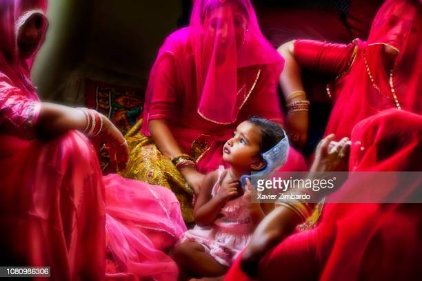Young women surround a little girl as if to protect her with a lot of sweetness on June 12 2012 in Dhamli near Pali Rajasthan India