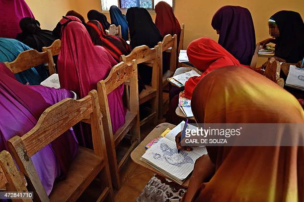 Young women take part in an art lesson at the Elman Peace and Human Rights Centre in Mogadishu on March 24 where survivors of sexual violence can...