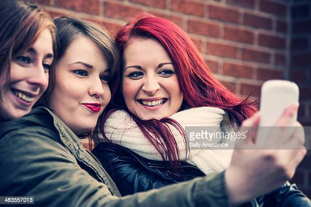 young women taking a selfie - only young women stock pictures, royalty-free photos & images