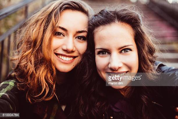 young women taking a selfie - sister stock pictures, royalty-free photos & images